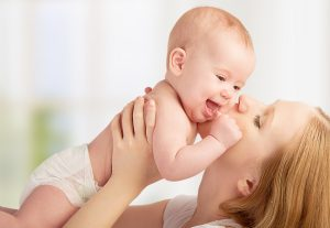 Happy family. young mother kissing a baby